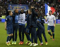 FBL-WC2014-FRA-UKR French players celebrate at the end of the FIFA World Cup 2014 qualifying football match France vs Ukraine, on November 19, 2013 at the Stade de France in Saint-Denis, outside Paris. France won 3-0 to overturn a two-goal first-leg deficit and qualify for the World Cup finals. AFP PHOTO / FRANCK FIFE (Photo credit should read FRANCK FIFE/AFP/Getty Images)