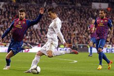 Real Madrid star Cristiano Ronaldo scores during a Cop del Rey match against FC Barcelona in Madrid.