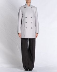 Mid-length jacket with removable sleeves to make it a vest.