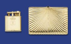 A CIGARETTE CASE, BY H WEISS, AND LIGHTER, BY DUNHILL  The cigarette case with cabochon sapphire clasp to the fluted rays, with side compartment for matches and aperture for tinder cord, inside cover engraved and dated 1938, weight 260.4 grams, 10.7 cm. long, the lighter with crowned addorsed Cs, circa 1935, 5.3 cm. high Cigarette case signed Weiss Bucarest, lighter with maker's mark AD, probably for Alfred Dunhill, No. 143752