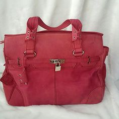 """Stunning!!! Donald J. Pliner pink suede handbag You will certainly be noticed carrying this magnificent statement bag! Beautiful pink sueded leather with silver hardware, including lock and key, metal feet. Magnetic and zip closures. 17"""" w (at its longest point), 11"""" h and 6"""" d. Comes with optional  long, shoulder strap still in wrapping. Carried only 2-3 times.... Impeccable condition! Donald J. Pliner Bags Satchels"""
