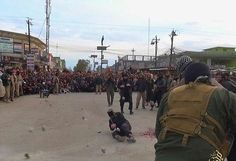 Stoned to death: The terror group broadcast this image of a man and women being stoned to death for having sex before marriage, as the barbaric list which surfaced on an ISIS propaganda website proclaims