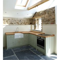 Designed in conjunction with our customer's own specific design ideas in the the in-framed Shaker style this kitchen is part of a rural barn conversion in St. Davids, West Wales. The challenge was to create a functional and attractive kitchen area and also make the best of existing original features within the room.