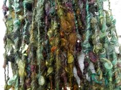 FIREFLY art yarn / hand spun / hand dyed / wool curls / green yellow red gold…
