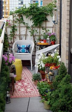 Small balcony   - rug, splashes of color, trellis, greenery and flowers.  Also light/candle on wall for ambiance at night