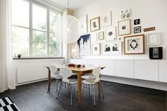 """Art Wall + Dark Floors + White Walls  Also style of cabinets for """"buffet"""" in dining area. dont like the light"""
