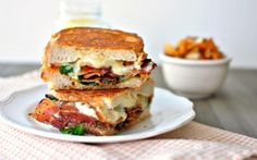 Fancy BLT Grilled Cheese Sandwiches, with sundried tomato and walnut pesto, Fontina cheese, and peppered bacon, this sandwich is seriously delicious.