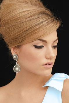 Updo, cat eyes and pretty pale blue on the shoulder