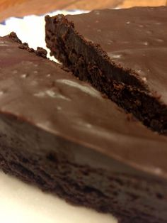 Flourless Chocolate Cake - no weird ingredients. =)  With 1/2 c sugar and 70% chocolate and 10 servings: 385 Cal, 29 carbs, 28 Fat, 6 Protein, 20 Sugar.