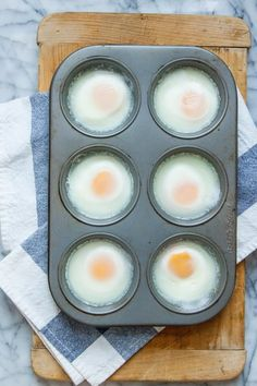 While poached eggs make a lovely and elegant brunch addition I find myself shying away from them when I'm cooking for more than a few people. The timing and logistics of poaching eggs for a crowd can be tricky. There may be a solution though swapping Eggs In Muffin Tin, Muffin Tin Recipes, Muffin Tins, Muffin Egg Bake, Pancake Recipes, Waffle Recipes, How To Make A Poached Egg, How To Cook Eggs, Making Poached Eggs