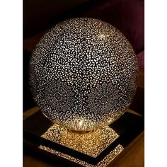 Elegant and refined, this Moroccan table lamp casts beautiful shadows through the intricate openings www. Moroccan Table Lamp, Moroccan Lighting, Moroccan Art, Moroccan Lanterns, Silver Walls, Gourd Lamp, Photo Candles, Light Of The World, Candle Lanterns