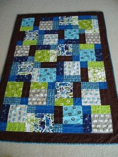 Disappearing nine patch pattern - love the colors and the quilting - would be a nice baby blanket