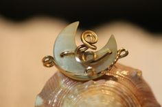 Vintage Half Moon Lucite Brass Scroll Pin. Starting at $5 on Tophatter.com!