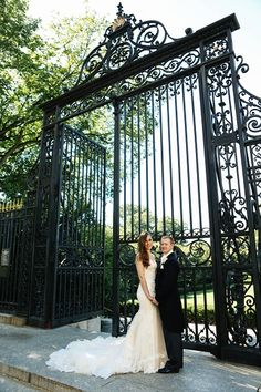 bride and groom by the Vanderbilt Gate in the Conservatory Gardens | Central Park Weddings