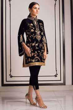 The classic black velvet kurta with an antique gold jaal, is a winter wardrobe staple. Pair it up with this hand embellished velvet pants with side slit to complete the look. Velvet Pakistani Dress, Pakistani Dress Design, Pakistani Dresses, Indian Dresses, Indian Outfits, Stylish Dress Designs, Stylish Dresses, Fashion Dresses, Dress Indian Style