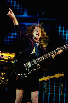 AC/DC: Four Decades of Big Riffs and Schoolboy Uniforms Pictures - AC/DC Timeline: 1991: Angus Young Shouting | Rolling Stone