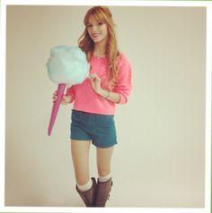 Pink shirt, blue shorts, brown boots