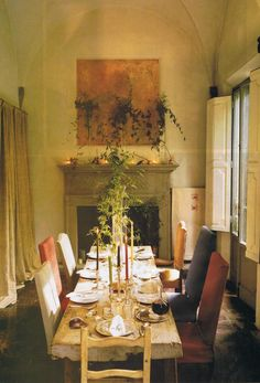 French alpine dining table is set with 18thC pewter plates  and 19thC silverwear. Axel Vervoordt House and Garden 2002