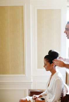 Brides.com: A Glamorous Summer Wedding in New York City. Before slipping on her gown, Mallorie styled her hair in a high, ballerina-inspired bun.