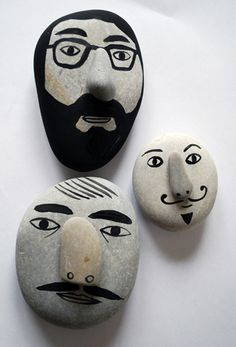 Love the various beard/mustache details on these painted rocks.