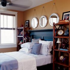 Ideas for Creating your own Spectacular Nautical 'Headboard' Area, love the color on the headboard and then mirrors above.not crazy about boxing it all in between those tall shelves though....