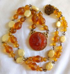 I love this amber translucent neckace! It has the appearance of celluloid, but I…