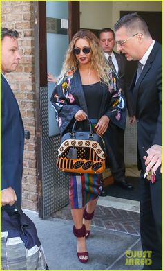 Beyonce Helps Raise Over $80,000 for Flint Victims: Photo #3682001. Beyonce wears a colorful outfit while stepping out of her apartment on Tuesday morning (June 14) in New York City. The 34-year-old entertainer was joined by her…