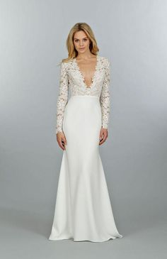 Click to see 46 wedding dresses we love, including this long-sleeve gown with lace sleeves and a deep v-neck.