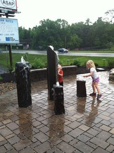 Young customers enjoying our water feature! June 2014