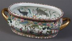 """CHINESE PORCELAIN FOOT BATH - Painted and gilt Chinese foot bath with handles. Exterior depicts courtesans in a garden. Interior depicts fish, crustaceans and various types of water foliage. Condition good, no chips or damage noted. Late 20th century. 8"""" x 18"""" x 10.5"""" diam"""