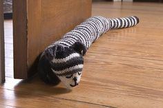 Adorable and useful draft stopper. http://www.simplicity.com/t-free-crochet-project-knit-cat-draft-stopper.aspx
