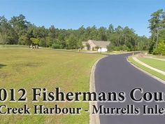 This is a 2.2 acre waterfront lot on Collins Creek in Creek Harbour a private gated upscale Intracoastal Waterway community. Amenities include lap and swimming pool cook-out gazebo clubhouse with kitchen playground area 150 ft. floating community dock boatRV storage and boat ramp with day docks. Short drive to the beach shopping restaurants Murrells Inlets popular Marsh Walk and beautiful Brookgreen Gardens.