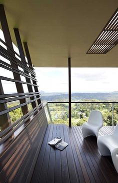 """Owners of the Maleny House (or the """"Glass House Mountain House"""" in Maleny, Australia) challenged Australian Bark Design Architects to design a complex, landscape-interacting residential structure."""
