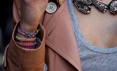 Bright friendship bracelets worn with nudes.