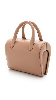 Structured, sculptural Maison Martin Margiela nude leather handbag in an eclectic, petite silhouette
