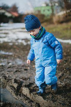 Boy playing in the mud by Amir Kaljikovic - Childhood, Mud - Stocksy United Blue Rain, Boys Playing, Young Boys, Mud, Rain Jacket, Windbreaker, Childhood, The Unit, Jackets