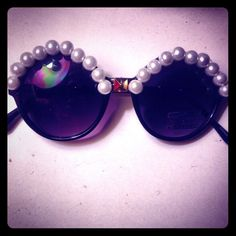 Pearl framed sunnies Stand out with these haute frames, round shaped one of a kind half pearl sunnies and a stud in the middle. It's the perfect mix of girlie and rocker chic to your accessory stash. Frames made in china and were given new life in the heart of LA. Accessories Sunglasses