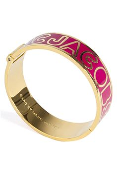 Hinge bangle featuring a pop of colour with the signature Marc By Marc Jacobs logo. #Marcbymarcjacobs