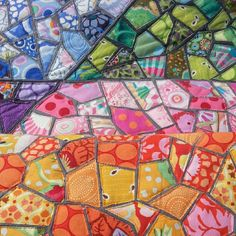 Close up of my mosaic quilt! I ironed heat and bond onto back of rectangles of fabric then from thoserectangles i cut out each mosaic shape ...