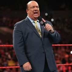 Paul Heyman is an American Wrestling manager, commentator, performer, marketing manager and writer. He is currently under contract with WWE Seth Rollins, Rob Van Dam, Paul Heyman, World Championship Wrestling, Kurt Angle, Green Hair Colors, Wwe Champions, Holocaust Survivors, Brock Lesnar