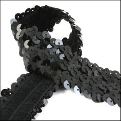 1 Meter of glossy black elastic sequin trim. 32mm  by SequinSuzy