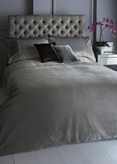 The perfect to way to add some luxury to your bedroom, this velvet duvet cover has a beautiful silver sheen with a contrasting grey cuff. Crafted with...