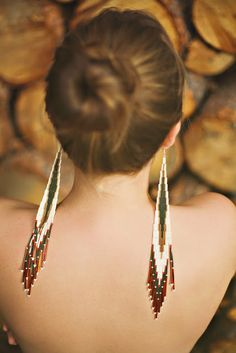 hmmm - what an interesting idea. earrings that hang down your backless dress. #yes