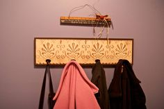 make your own coat rack using trim board and pegs