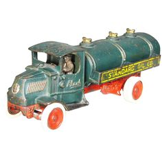 Large Arcade Toys Cast Iron Truck. Standard Oil Co. Mack Truck, green. Original rubber wheels. Very good original condition. 13 inches long....
