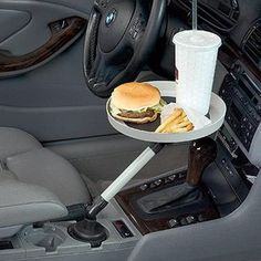 No more lunches in your lap! Tray's textured surface keeps items from sliding all over the place. Swivel it over to the passenger side when you don't need it.