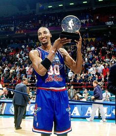 Scottie Pippen of the Chicago Bulls with the MVP trophy as the East with a 127-118 victory over the West at the 1994 NBA All-Star Game from Minneapolis, MN