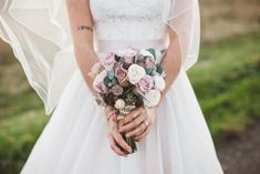 Rich berry & cream winter wedding bridal bouquet - Image by  Christopher Currie Photography - An Essense of Australia wedding dress for a Winter wedding at  Kinkell Byre in Scotland with a pastel rose bouquet photographed by Christopher Currie.