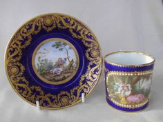 SUPERB SEVRES  JEWELLED PORCELAIN CUP AND SAUCER - ROMANTIC PASTORAL SCENES