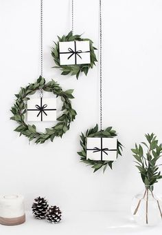 leafy wreaths with gift boxes inside for a modern look